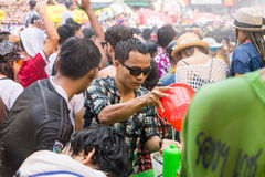 Songkran festival on April 14, 2015 Chiangmai,Thailand. CHIANG MAI THAILAND - APRIL 14 : Chiangmai Songkran festival.Unidentified  traveler  enjoy and fun with Royalty Free Stock Photography