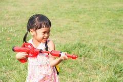 Songkran festival. Asian little girl play water gun in Songkran festival Thailand stock photo