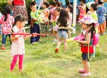 Songkran festival. Asian little girl play water gun in Songkran festival Thailand stock images