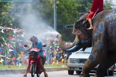 Songkran Festival in Ayudhya - Thai festival. AYUDHYA, THAILAND - APR 14:  People enjoy water splashing with elephants on Apr 14, 2012 in Ayudhya, Thailand. The Royalty Free Stock Photography