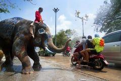 Songkran Festival in Ayudhya - Thai festival. AYUDHYA, THAILAND - APR 14:  People enjoy water splashing with elephants on Apr 14, 2012 in Ayudhya, Thailand. The Stock Image