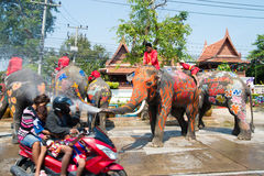 Songkran Festival in Ayuttaya. AYUTTHAYA, THAILAND - APR 14:  Revelers enjoy water splashing with elephants during Songkran Festival on Apr 14, 2015 in Ayutthaya Stock Photos