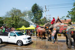 Songkran Festival in Ayuttaya. AYUTTHAYA, THAILAND - APR 14:  Revelers enjoy water splashing with elephants during Songkran Festival on Apr 14, 2015 in Ayutthaya Royalty Free Stock Photography