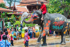 Songkran Festival in Ayuttaya. AYUTTHAYA, THAILAND - APR 14: Revelers enjoy water splashing with elephants during Songkran Festival on Apr 14, 2015 in Ayutthaya Stock Photography