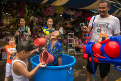 The Songkran festival in Bangkok, Thailand. Bangkok, Thailand - April 13, 2014 : The Songkran festival or Thai New Year`s festival in JJ market in Bangkok royalty free stock image