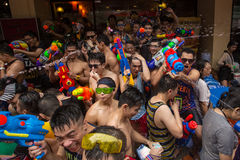 The Songkran festival in Bangkok, Thailand. Bangkok, Thailand - April 13, 2014 : The Songkran festival or Thai New Year`s festival on Silom street in Bangkok royalty free stock photo