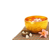 Songkran festival - Bowl of water with flowers Royalty Free Stock Image