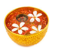 Songkran festival - Bowl of water with flowers Royalty Free Stock Photography