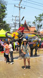 Songkran Festival is celebrated with elephants in Ayutthaya. The Songkran festival (Thai: สงกรานต์) is celebrated in Thailand as the traditional royalty free stock image