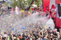 Songkran Festival - Chiang Mai. Chiang Mai, Thailand – April 14, 2014: A group of people is sprayed with water by staff at the Air Asia stage at the Songkran Stock Image