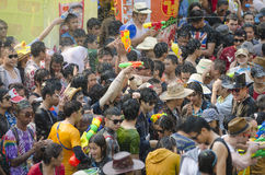 Songkran Festival - Chiang Mai. Chiang Mai, Thailand – April 14, 2014: A large group of people take part in the Songkran festival in Chiang Mai, Thailand on royalty free stock photo
