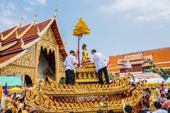 Songkran festival. CHIANG MAI, THAILAND - APRIL 13: Buddha Phra Singh of Phra Singh temple was moved to the parade cars for pour water in Songkran festival on Stock Photography
