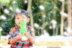 Songkran festival. The little boy play bubble  at songkran water  festival in thailand Royalty Free Stock Images