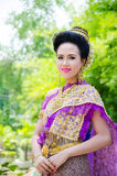 Songkran Festival 2015. LOPBURI - APRIL 13: Unidentified model in period dress on Songkran Festival is celebrated in Thailand as the traditional New Year's at Royalty Free Stock Photo