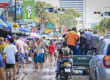 Songkran festival - People and traveler to play water splash on streets of the Pattaya city. Thailand,. PATTAYA CITY , THAILAND - 2014 APRIL 19: Celebration of stock photo