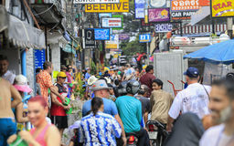 Songkran festival - People and traveler to play water splash on streets of the Pattaya city. Thailand, Stock Photo