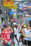 Songkran festival - People and traveler to play water splash on streets of the Pattaya city. Thailand, Royalty Free Stock Photography