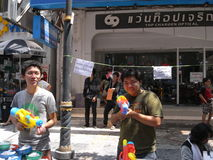 Songkran festival at Silom Road in Bangkok on April 2012. Usually non-Thai people is not targeted in this water battle, but there is always an exception. I Royalty Free Stock Photography