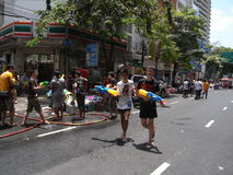 Songkran festival at Silom Road in Bangkok on April 2012. Usually non-Thai people is not targeted in this water battle, but there is always an exception. I royalty free stock images