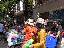 Songkran festival at Silom Road in Bangkok on April 2012. Usually non-Thai people is not targeted in this water battle, but there is always an exception. I Stock Photo