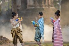 Songkran festival. Festival Songkran, Thai girls and laos girls splashing water during festival Songkran festival,Water blessing ceremony of adults stock image