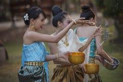 Songkran festival. Festival Songkran, Thai girls and laos girls splashing water during festival Songkran festival,Water blessing ceremony of adults royalty free stock photography