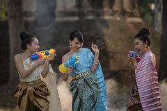 Songkran festival. Festival Songkran, Thai girls and laos girls splashing water during festival Songkran festival, Water blessing ceremony of adults royalty free stock photography