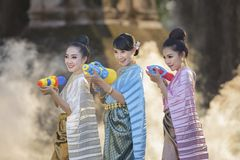 Songkran festival. Thai girls and laos girls splashing water during Songkran festival,Water blessing ceremony of adults,Buddha statue water ceremony in songkran Stock Images