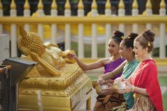 Songkran festival. Thai girls and laos girls splashing water during Songkran festival,Water blessing ceremony of adults,Buddha statue water ceremony in songkran Stock Photos