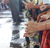 Songkran festival - Thai older person day. Elder person hands wet and wrikled royalty free stock photos