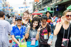 Songkran Festival in Thailand. BANGKOK - APRIL 13: Songkran Festival is celebrated in Thailand as the traditional New Year's at Khao San Road on April 13, 2014 Stock Image