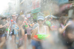 Songkran Festival in Thailand. BANGKOK - APRIL 13: Songkran Festival is celebrated in Thailand as the traditional New Year's at Khao San Road on April 13, 2014 Royalty Free Stock Images