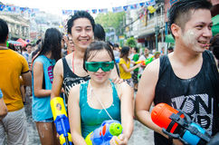 Songkran Festival in Thailand. BANGKOK - APRIL 13: Songkran Festival is celebrated in Thailand as the traditional New Year's at Khao San Road on April 13, 2014 Stock Photos