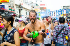 Songkran Festival in Thailand. BANGKOK - APRIL 13: Songkran Festival is celebrated in Thailand as the traditional New Year's at Khao San Road on April 13, 2014 Royalty Free Stock Image