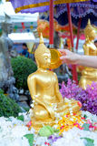 Songkran Festival, Thailand. Close-up Thai people pouring water bathing on Buddha statue in Songkran Festival, Thailand Stock Photography