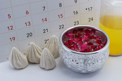 Songkran Festival (Thailand New Year) concept. Calendar of Songkran Festival (Thailand New Year) during 13-15 April with the concept of a silver bowl filled with Stock Images