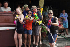 The Songkran Festival in Thailand. Tourists with water guns at the Songkran Festival in Chiang Mai, Thailand Royalty Free Stock Photography