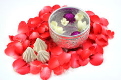 Songkran festival, Thailand. Water with jusmine and roses corolla in bowl and soft-prepared chalk for Songkran festival, Thailand Royalty Free Stock Photography