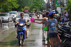 The Songkran Festival in Thailand. Woman splashing water on the street during the Songkran Festival in Chiang Mai, Thailand Royalty Free Stock Photography