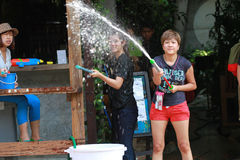 Songkran festival. Tourist spray water in Songkran festival Royalty Free Stock Photography