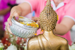 Songkran festival. Water pouring to buddha statue in songkran festival tradition of thailand Stock Images