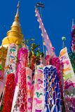 Songkran flags with pagoda. At temple in Lamphun, Thailand royalty free stock image
