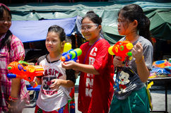 Songkran girls. Bangkok, Thailand, 15 April 2015. A trio of girls getting ready to take part in the annual Songkran water festival stock images