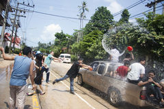 Songkran -  New Year in Thailand. The celebration of Songkran - Thai New Year in Thailand. On this day people pour water on each other. According to Thai Stock Images