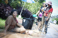 Songkran -  New Year in Thailand. The celebration of Songkran - Thai New Year in Thailand. On this day people pour water on each other. According to Thai Stock Photo