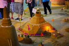 Songkran Pagoda. ANG THONG, THAILAND - APRIL 15,2013 : Thai people and children enjoying to the activity of building sand pagodas in Songkran Festival Night at stock image