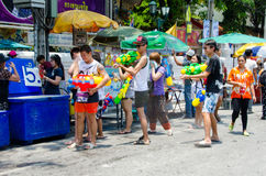 Songkran partygoers. Bangkok, Thailand, 13 April 2015. Festival goers at Khao San Road spraying each other with water guns during the annual Songkran water royalty free stock images