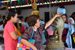 Songkran's day. Phrae, Thailand - April 13, 2014: People are coming to paying respect to the Buddha at Wat Phrathatchohae on Songkran's day, Phrae, Thailand Stock Images