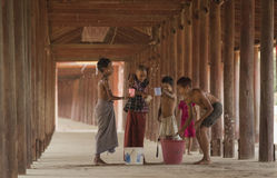 Songkran Of Salay,Myanmar. SONGKRAN,SALAY,MYANMAR- Murch 10,2016 Groups children were splashing water. The temple due to the weather in Salay. Heat through to Royalty Free Stock Photos