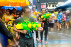 Songkran shooters. Bangkok, Thailand, 13 April 2015. Festival goers at Khao San Road spraying each other with water guns during the annual Songkran water Royalty Free Stock Image